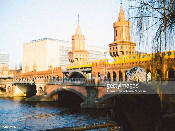 Rear View Of Woman In Front Of Oberbaum Bridge