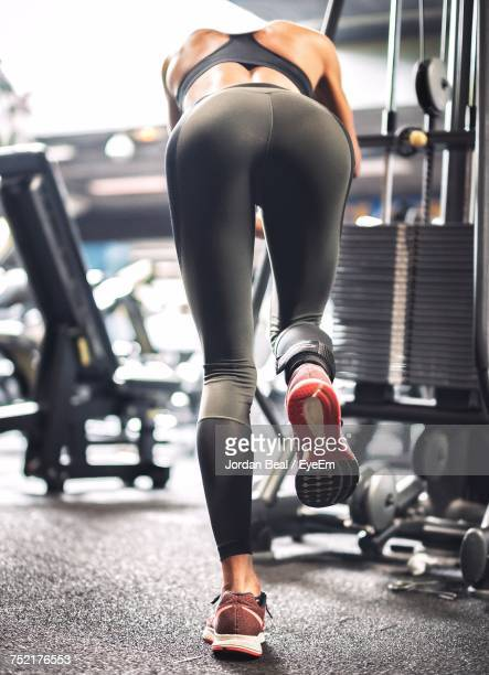 rear view of woman in gym - bending over stock pictures, royalty-free photos & images