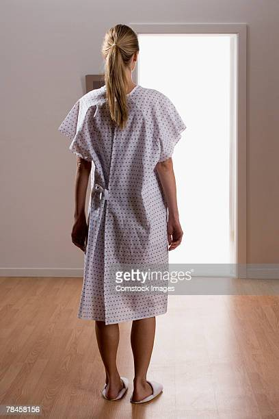 Rear view of woman in hospital gown