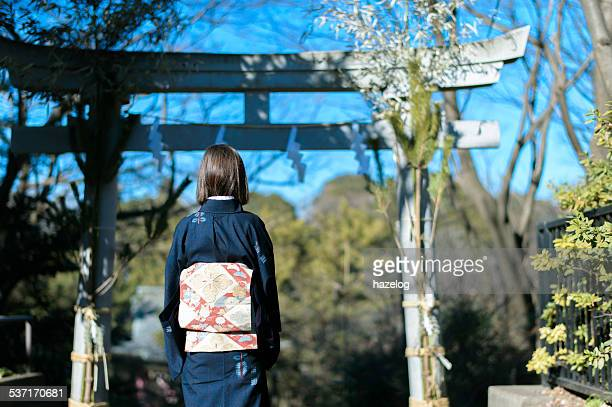 rear view of woman in kimono and shrines gate - shrine stock pictures, royalty-free photos & images