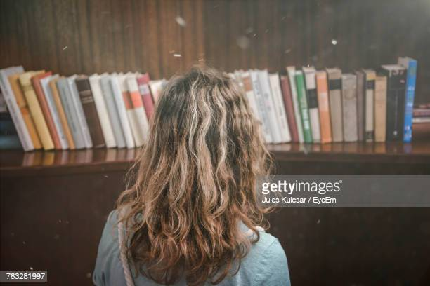 Rear View Of Woman In Library