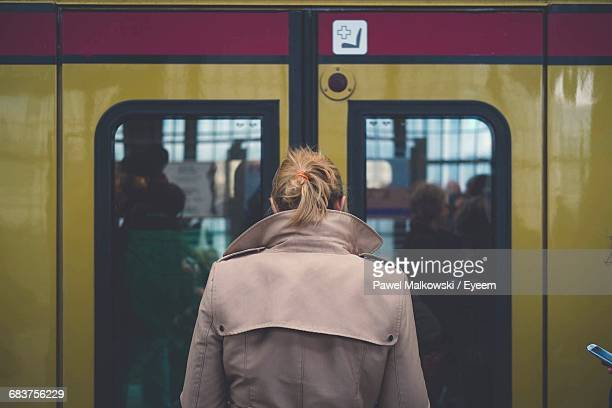 Rear View Of Woman In Train