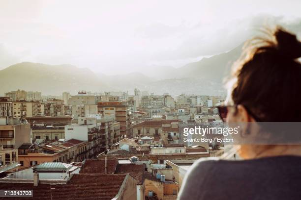rear view of woman looking at cityscape - one young woman only stock pictures, royalty-free photos & images