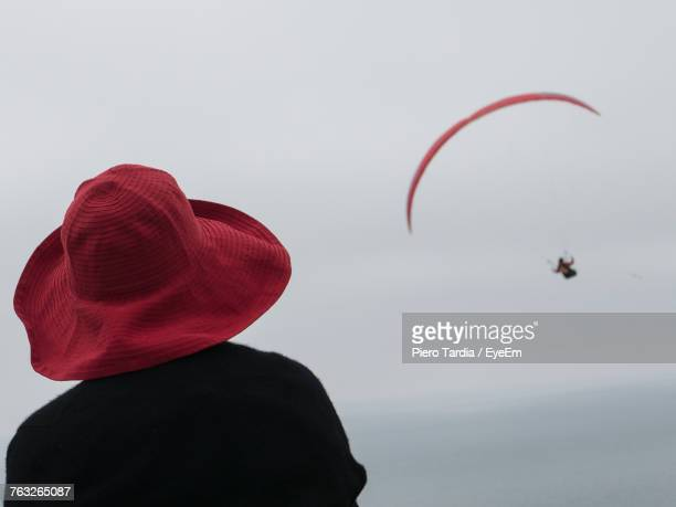 Rear View Of Woman Looking At Friend Paragliding