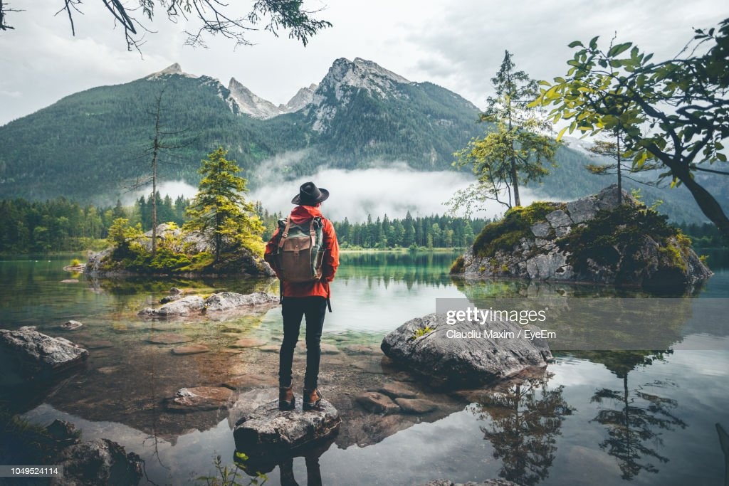 Rear View Of Woman Looking At Lake Against Mountains : Stock Photo