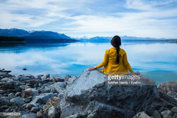 rear view of woman looking at lake against sky - wellington new zealand stock pictures, royalty-free photos & images