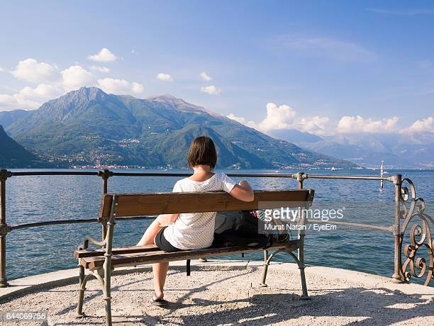 rear view of woman looking at lake como against mountain - one young woman only stock pictures, royalty-free photos & images