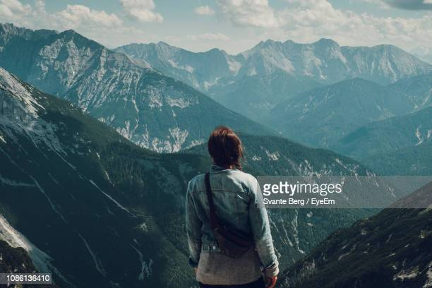 rear view of woman looking at mountains - mittenwald stock pictures, royalty-free photos & images