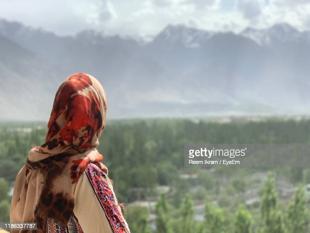 rear view of woman looking at mountains - pakistan stock pictures, royalty-free photos & images