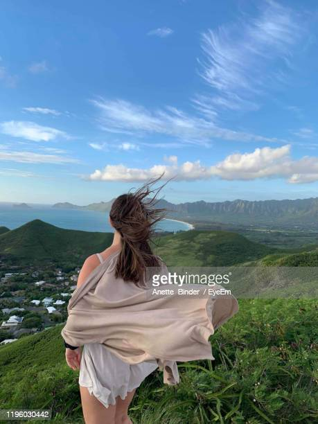 rear view of woman looking at mountains - kailua stock pictures, royalty-free photos & images