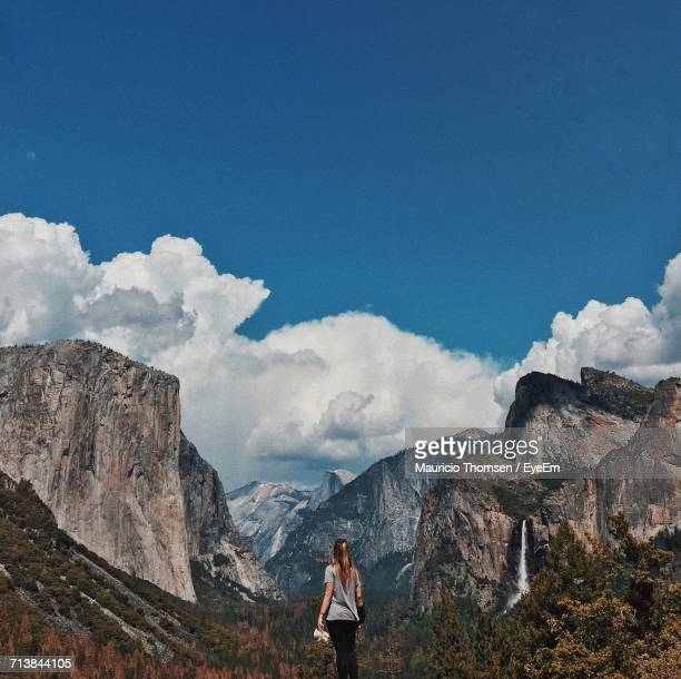 Rear View Of Woman Looking At Rocky Mountains In Yosemite National Park