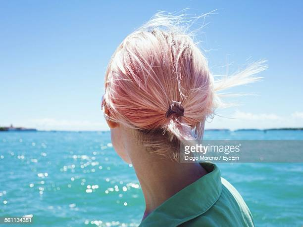 Rear View Of Woman Looking At Sea