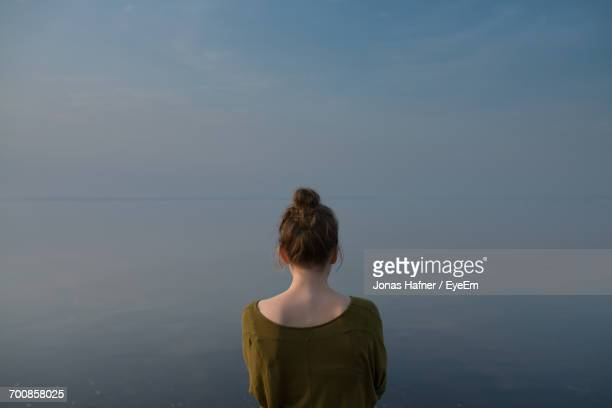 Rear View Of Woman Looking At Sea View