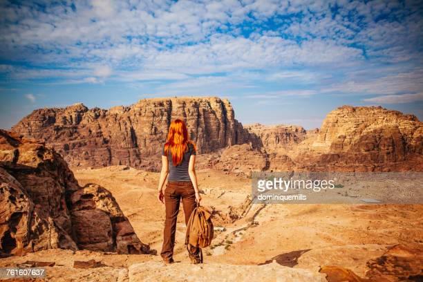 Rear view of woman looking at view, Wadi Rum, Aqaba, Jordan