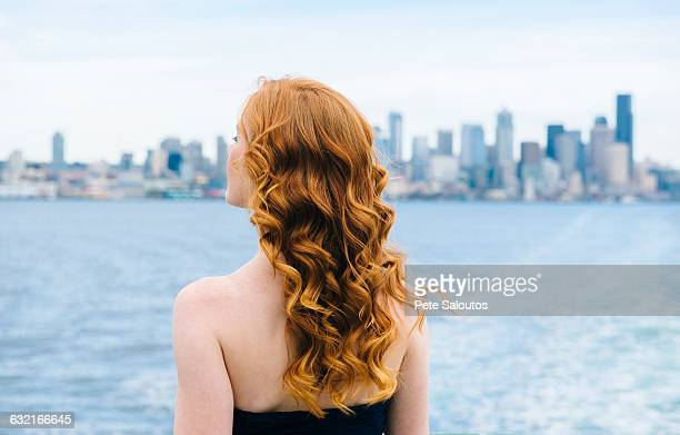 rear view of woman looking out from passenger ferry on puget sound, seattle, usa - wavy hair stock pictures, royalty-free photos & images