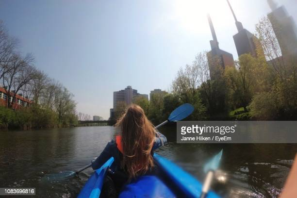 rear view of woman on boat in river against sky - hanover germany stock pictures, royalty-free photos & images