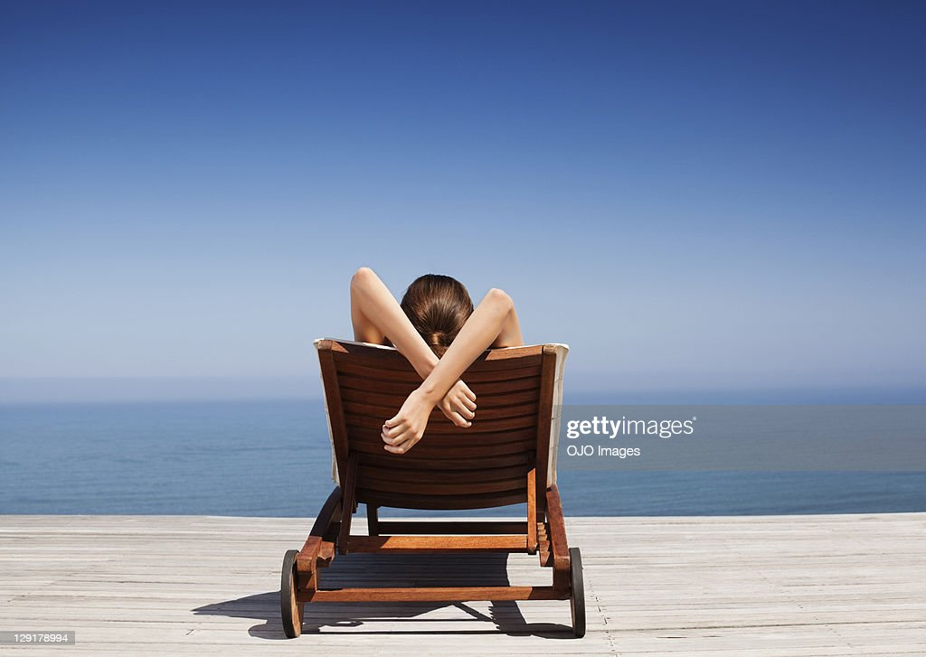 Rear view of woman on deck chair : Stock Photo