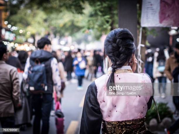 rear view of woman on street - jeonju stock photos and pictures