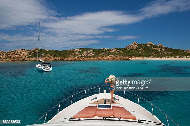 Rear View Of Woman On Yacht Boat Deck In Aegean Sea Against Sky
