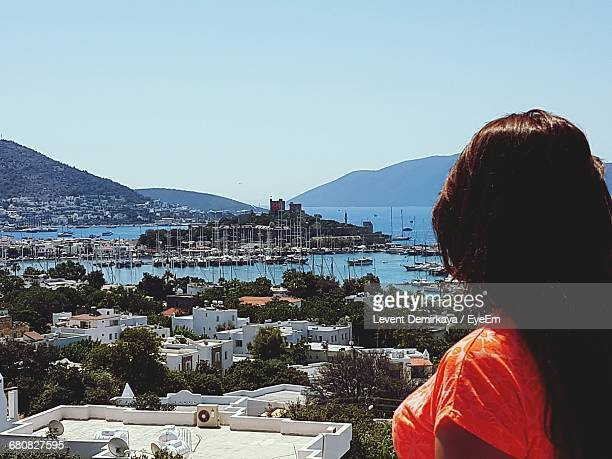 Rear View Of Woman Overlooking Built Structures