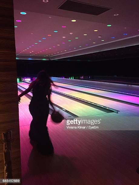 Rear View Of Woman Playing Bowling