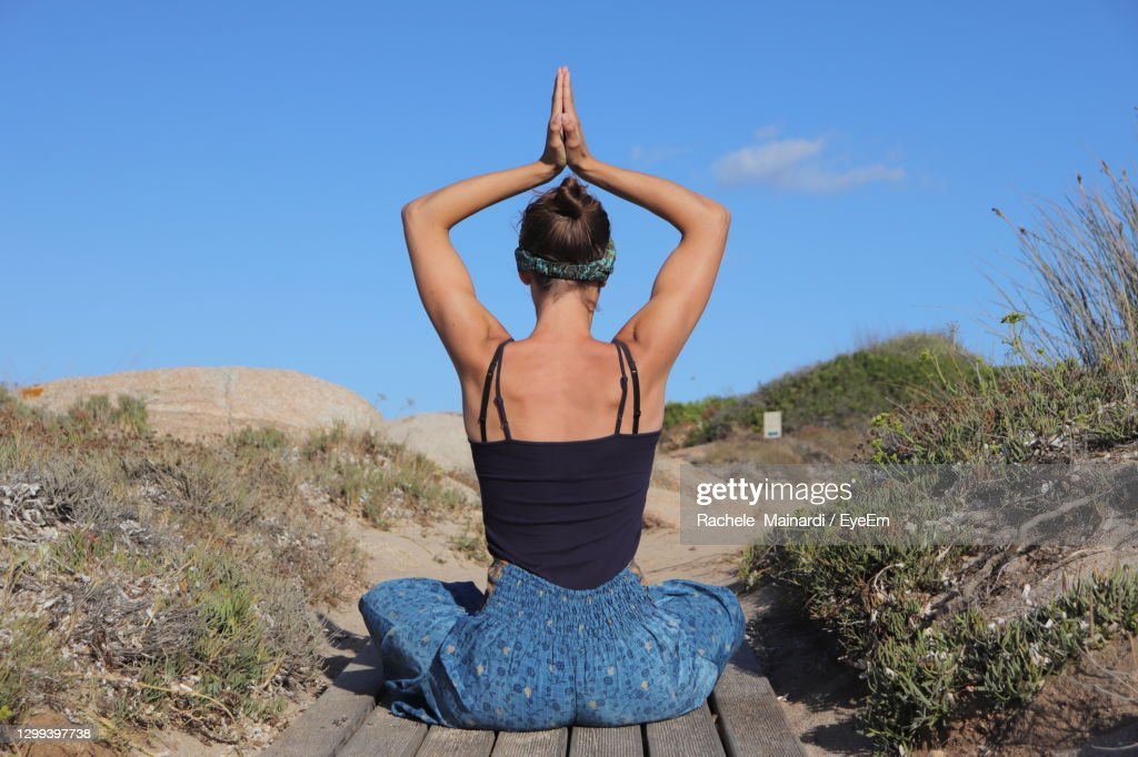 Rear View Of Woman Practicing Yoga : Stock Photo