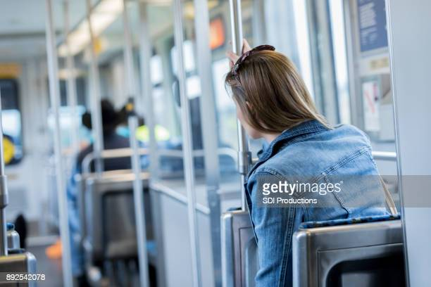Rear view of woman riding a commuter train