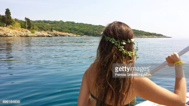 Rear View Of Woman Sailing Boat On Sea