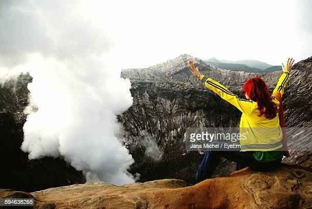 Rear View Of Woman Sitting At Mt Bromo