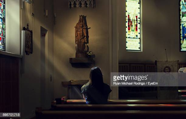 Rear View Of Woman Sitting In Church