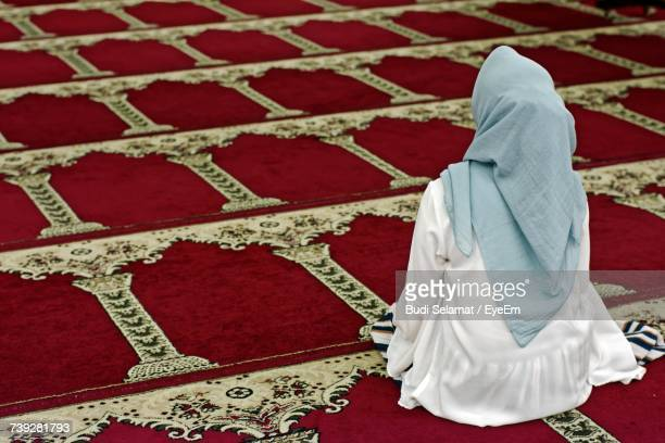 Rear View Of Woman Sitting In Mosque