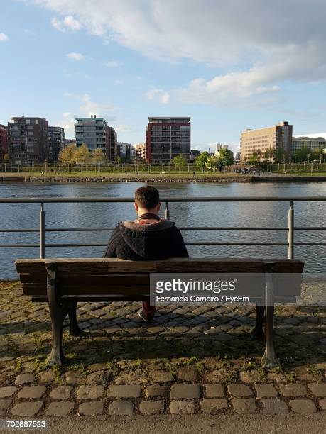 Rear View Of Woman Sitting In River
