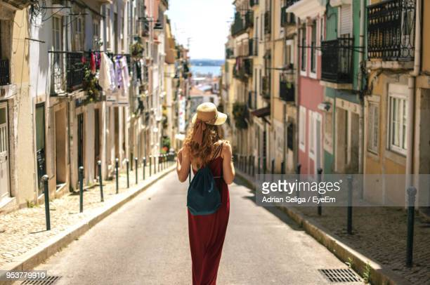 rear view of woman standing against building - portugal stock pictures, royalty-free photos & images