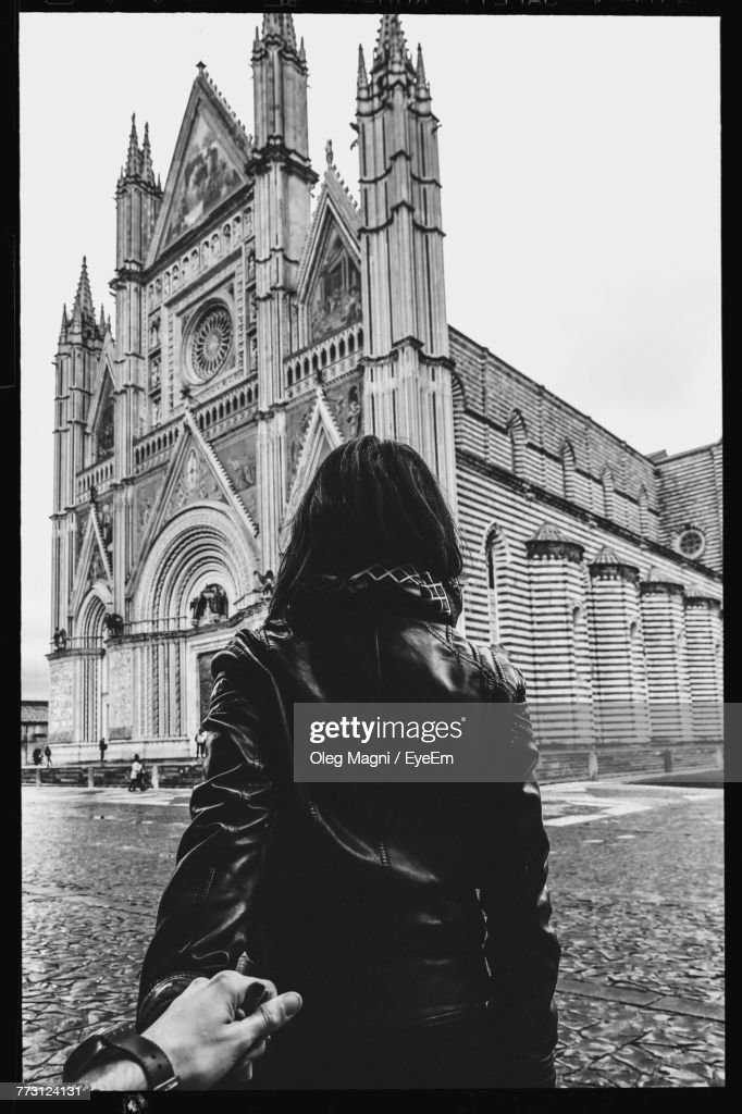 Rear View Of Woman Standing Against Church : Photo