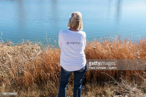 Rear View Of Woman Standing Against Lake