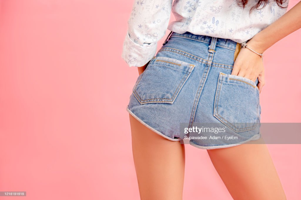 Rear View Of Woman Standing Against Pink Background : Stock Photo