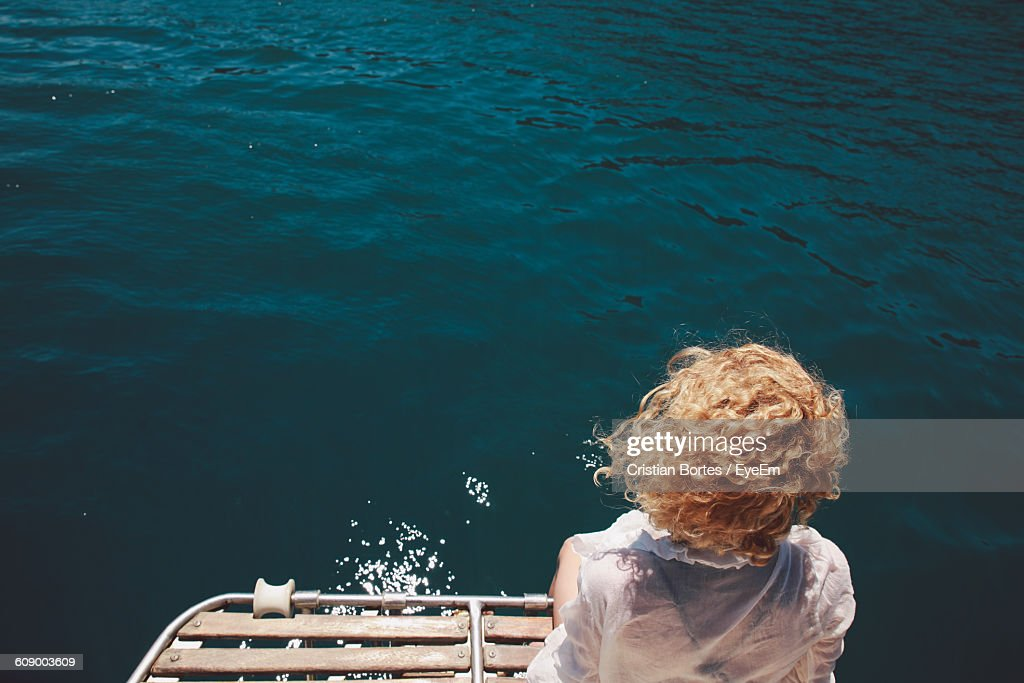 Rear View Of Woman Standing Against River : Stock Photo
