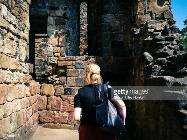Rear View Of Woman Standing At Abbey Ruins