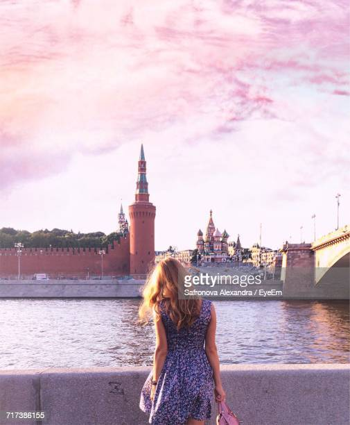 Rear View Of Woman Standing By River Against Kremlin