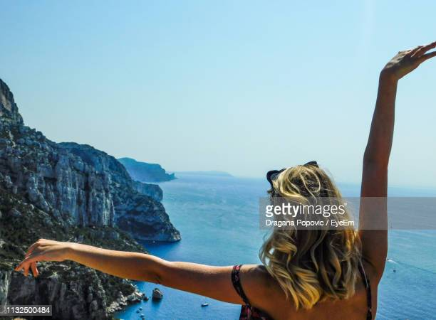 rear view of woman standing by sea against clear sky - marseille stock pictures, royalty-free photos & images