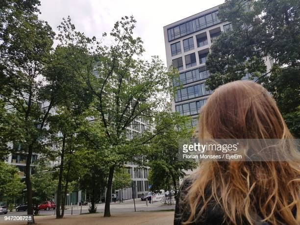 Rear View Of Woman Standing In City