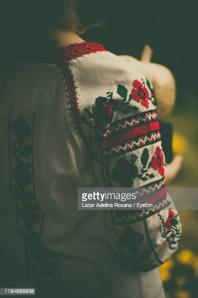 rear view of woman standing in darkroom - botoșani romania stock pictures, royalty-free photos & images