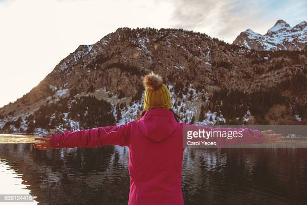 rear  view of Woman standing in front of  on panticosa lake, Huesca, Spain