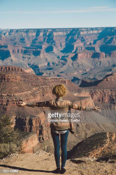 rear view of woman standing on desert - bortes stock pictures, royalty-free photos & images