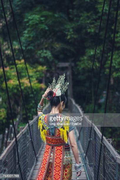 rear view of woman standing on footbridge - sarawak state stock pictures, royalty-free photos & images