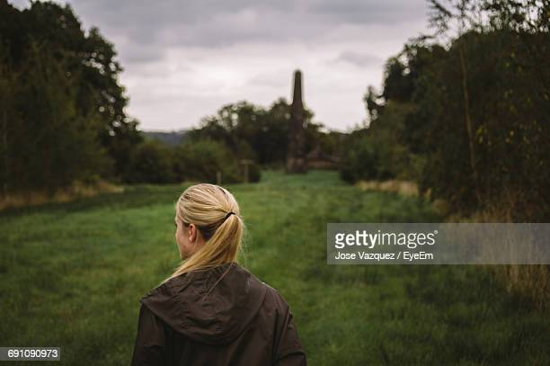 Rear View Of Woman Standing On Grassy Field At Wentworth Castle Gardens