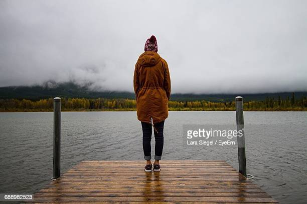 Rear View Of Woman Standing On Pier Over Lake Vermilion At Banff National Park