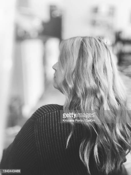 rear view of woman standing outdoors - anaheim california stock pictures, royalty-free photos & images