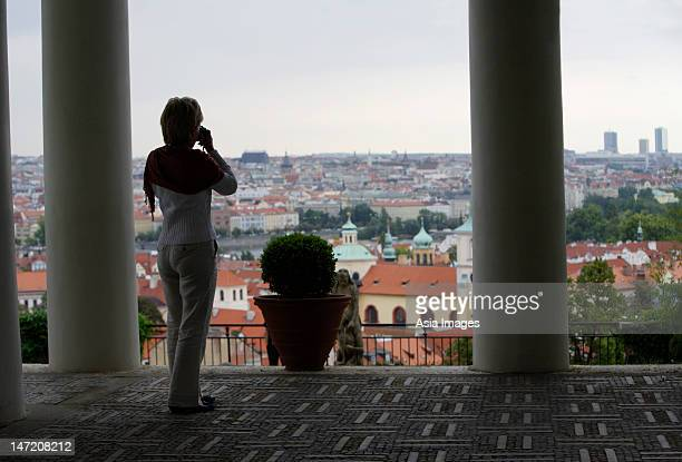 rear view of woman taking a photo of Prague