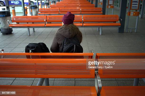 Rear View Of Woman Waiting At Bus Station